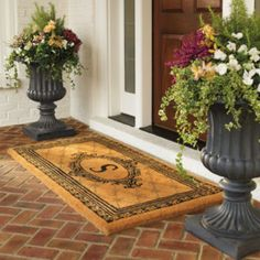 Symmetrical urns and door mat