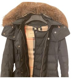 Shop the Best of Burberry at Up to 70% Off Store Prices. New & Pre-Owned Luxury Fashion from the Marketplace Made By Women, For Women. Burberry Brit's classic black puffer coat is padded with goose down for maximum warmth and comfort. The hood and the belt can be removed so you can switch up your look, and the two-way zip fastening offers flexibility of movement. Iconic print on the inside. This jacket has genuine incredibly soft rabbit fur attached to the hood (I did this myself, it did not