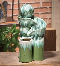Enjoy the sights and sounds of moving water anywhere! This Ceramic Green Globe Water Fountain is beautifully shaped with a spherical globe at the top. This tabletop piece of artwork brings the soothing sights and sounds of moving water to your home or garden. Completely self-contained and so easy to use - just add water, plug in and enjoy. The recirculating pump with 5'L electric cord sends the water back to the top for non-stop flow. Tabletop Water Fountain, Outdoor Water Features, Moving Water, Glazed Ceramic, Calla Lily, Beautiful Artwork, Garden Art, Globe, Ceramics