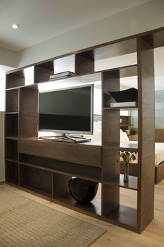 Tv partition / master bedroom unit by basch architects Scandinavian wood wood finish Tv Stand Room Divider, Bedroom Divider, Room Divider Shelves, Room Dividers, Home Room Design, Home Interior Design, Living Room Designs, Living Room Decor, House Design