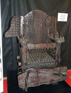 The Interrogation Seat. Torture Device. Middle Ages. Timber with sharp nails and vice grips.