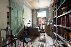 The room at the front of Louise Bourgeois' New York townhouse. She liked to sit at the desk and look out onto the street. (Nicholas Calcott)