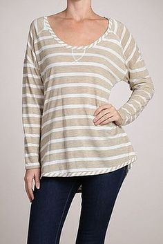Longsleeve scoop oatmeal colored neck top.  65% Polyester / 35% Rayon  Hand Wash Cold / Do Not Tumble Dry / Flat To Dry