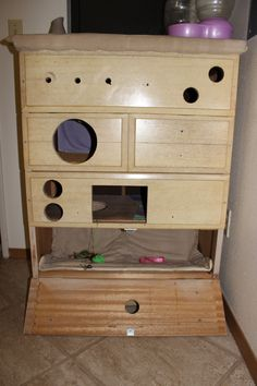 **Didn't get this from Pinterest** Homemade cat house from an old dresser. Take out the drawers and use plywood for the different levels on the inside. Then use the drawers for the doors add some hinges on the bottom one so it can open! If you want a tutorial, just comment on this photo!