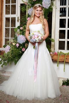French lace bodice and a soft tulle skirt and lace up back.