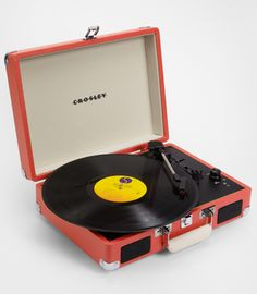 Crosley Cruiser Portable Turntable, $84.95. I love how compact it is and the variety of fun colors available to match any decor! xoxo, Carly. www.fredflare.com