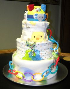 I'm not usually a fan of diaper cakes, but these ones are pretty cool and everything is really useful.  Ball of Fun Diaper Cake for Baby Shower. $74.99, via Etsy.