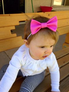 Pink and white polka dot bow headband. Available at www.etsy.com/shop/thelittlebowco