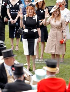 Sarah Ferguson, Duchess of York and Princess Beatrice wave to Queen Elizabeth II as they attend day 4 of Royal Ascot at Ascot Racecourse on June 23, 2017 in Ascot, England.