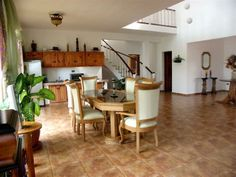 The villa has a large living room with a furnished open kitchen and dining.
