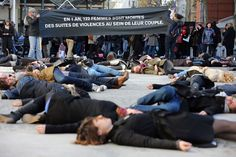 """PARIS.- French feminists of the """"Ni Putes, Ni Soumises"""" (Neither Whores Nor Submissive - NPNS) movement lie on the ground to simulate agressions on November 25, 2012 in front of the Centre Pompidou art center (aka Beaubourg) in Paris during the International Day for the Elimination of Violence Against Women...Banner in the background reads: """"In one year, 122 women died of domestic violence."""" AFP PHOTO THOMAS SAMSON."""