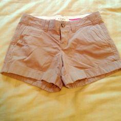Khaki shorts size 2 Worn twice for golf tournaments. Like new condition (wrinkly from being in a drawer)  soft material. 97% cotton, 3% spandex so there is some stretch, easy to move in! Old Navy Shorts