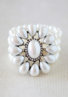 "Love Always Pearl Bracelet 32.99 at shopruche.com. Strands of faux pearls unite in an exquisite faux pearl flower ringed with glittering rhinestones on this decidedly romantic bracelet.  Elasticized band, Pendant: 3"" long, 2.5"" wide, ,"