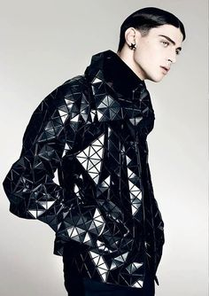 loose-fitting sculpted origami inspired jacket made up of hundreds of shiny black triangles - futuristic avant garde couture - Matthew Bell by Brendan Freeman for Volt - pinned by RokStarroad.com
