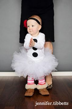 "Custom made snowman onesie or shirt with tutu. Tutu is white with sparkle tulle. The black buttons on the onesie are made 100% Kona Cotton that is pre-washed and sewn on.  Please provide onesie/t-shirt size when ordering. Below are the sizes that the tutu comes in. Also to make sure the tutu fits perfectly please provide your childs waist size.    0-12 months waist size approx 17- 19"" length approx  6""  12-24 months waist size approx 19"" - 21"" length approx 8"""