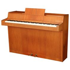 Danish Modernist Piano of Figured Teak, circa Early 1960s | From a unique collection of antique and modern musical instruments at https://www.1stdibs.com/furniture/more-furniture-collectibles/musical-instruments/