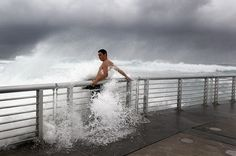 Florida, USA: A man braces himself as a wave bursts on to a pier at Boynton beach as hurricane Irene heads towards the east coast Hurricane Irene, Boynton Beach Florida, Moves Like Jagger, We Buy Houses, Sell My House, California Dreamin', Pick Up Lines, Road Runner, Country