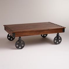 Henry Coffee Table | World Market - could probably make easily enough with pallets and old wheels.