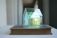 Set of 2 nesting acrylic houses - miniature iridescent rainbow house and glass - look house. 2of2