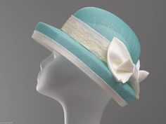 Hannah is a delightful formal hat complemented with a charming bow at the back. This headpiece is hand formed and sewed, making it an exclusive design. This artisan cocktail hat would perfectly compliment elegant outfit at a wedding or similar event.