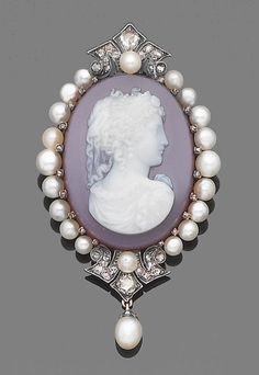 A late 19th century hardstone, pearl and diamond cameo brooch/ pendant  The hardstone cameo depicting Athena facing to her left, within a surround of pearls and rose-cut diamonds, suspending a single capped pearl, pearls remain untested, length 6.9cm.