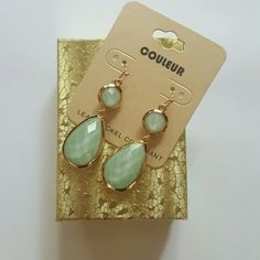 Tear Drop Shape Mint and Gold Color Earrings Metal color is gold and acrylic is color mint. Lenght of earrings is 2 inches long. Jewelry Earrings