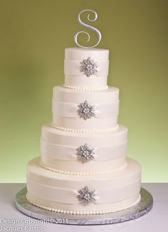 Power to Personalize Your Wedding: Winter Wedding Cakes but instead of ribbon, do a rustic rope to match the theme of a country winter. :)