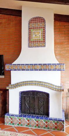 This kitchen fireplace is so dreamy with Mexican tile designs from bottom to top. Home Fireplace, Spanish Home Decor, Front Courtyard, Fireplace Tile, Mexican Style Homes, Fireplace Gallery, Backyard Fireplace, Talavera Tiles, Spanish House