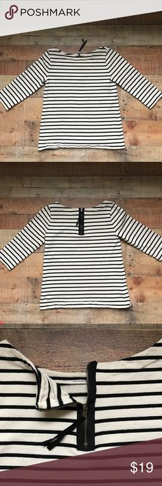 """LOFT Striped Zipper Back Top Black and cream gently used Loft top. The sleeves are 17"""" long and consider 3/4 sleeves. Zipper detailing on the back with black string pull. Measurements are 16W x 23""""L. Small discoloration near zipper on the inside (see third pic). Not noticeable when on. LOFT Tops"""