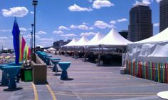 Pole tent setup for a party with 3000 people. Perry's Tents and Events can help you with any size party! 844-TENT PRO