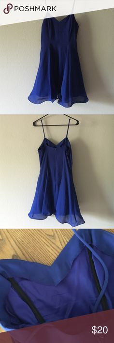 Simple cobalt blue dress Has plastic bones in the dress. Tule on the bottom to make it frill out! Has been altered from a long dress to a short one. Vintage. Says size 6 but fits a little smaller. Has fishing line through the bottom hem to make it fold and twirl around. Super cute. Hampton Nites Dresses Mini