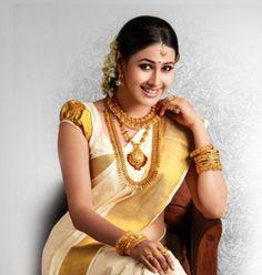 kerala wedding saree South Indian Bridal Jewellery, Indian Bridal Wear, Bridal Jewelry, Kerala Jewellery, Indian Wear, Indian Jewelry, Kerala Bride, South Indian Bride, Top Wedding Dress Designers