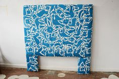 We built and upholstered this headboard custom for a client. The textile is a particularly lovely peacock blue embroidered Otomi quilt.