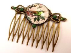 Nostalgic hair comb with bird on world map bronze by Schmucktruhe