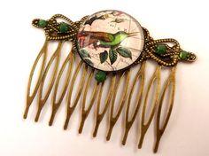 Nostalgic hair comb with bird on world map bronze by Schmucktruhe