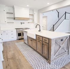 "What do you all think of the tile ""rug"" under the island? We think it adds such a unique and beautiful touch to this Designed by Featured Tile Home Decor Kitchen, Kitchen Interior, Kitchen Ideas, Interior Modern, Interior Design, Country Kitchen Flooring, Modern Farmhouse Kitchens, Home Kitchens, Modern Farmhouse Exterior"