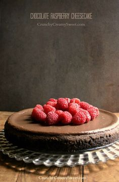 Chocolate Raspberry Cheesecake - rich and decadent cheesecake for the chocolate lovers. Topped with fresh raspberry sauce for a truly special dessert.