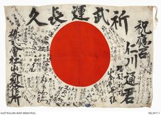 Japanese flag hinomaru (rising sun) with patriotic phrases and signatures. At top of flag is the traditional Good fortune & good luck in War. Written on the left is 'Yamaai Machinery Factory Ltd'. The signatures of work mates make up most of the Japanese writing on lower half of the flag and the area around the hinomaru. To the right in bold is 'Nikawa Toru', presumably the name of the flag's owner. In the upper right of the flag is a personal good luck message or slogan. Captured at Kokoda.