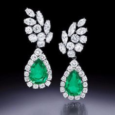A pair of Colombian emerald and diamond ear pendants, Ruser, each suspending a…