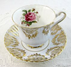 Paragon Tea Cup and Saucer Blue and Gold with Pink by TheAcreage