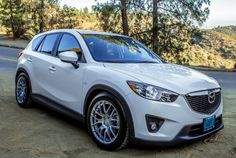 The equation starts with a 2013 Mazda CX-5 GT, and adds a custom coilover package developed with ProParts engineering. The CX-5 features Kon...
