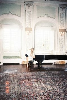 Cara Delevingne playing piano at Ferragamo's countryside house near Florence, July 2012