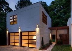 Inspiring Modern and Contemporary Garage Design Ideas: The Glass Garage Doors With The Wall Lights