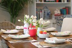 DIY easy Easter table decoration white tulips colorful jars