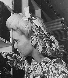 A lovely 1940s snood hairstyle (love that it matches her dress). #vintage #snoods #1940s #hair #fashion