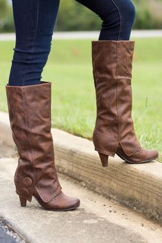 Heel boot with button detailing and fold over shaft. Not rated boots