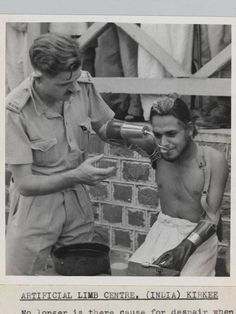 A young injured  Sikh soldier in World War 2 trying his artificial limbs.
