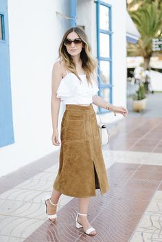 spring / summer - street style - street chic style - summer outfits - casual outfits - beach outfits - getaway outfits - travel outfits - brown suede a-line midi skirt + white frill cami top + white ankle strap block heel sandals + brown sunglasses