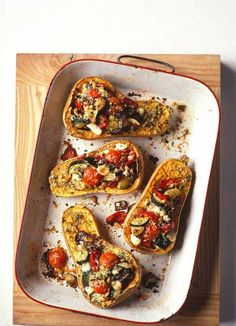 Roasted butternut squash with goat's cheese - A really attractive autumn recipe with sweet butternut squash halves stuffed with roasted vegetables and goat's cheese and finished with a scattering of breadcrumbs to make little eat-all vegetable gratins.