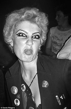 A regular at punk nights sticks her tongue out